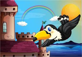 Un uccello vicino al castello con un arcobaleno nel cielo