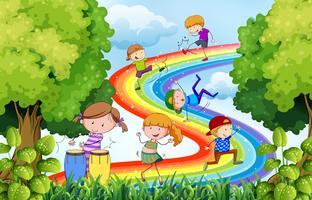 Bambini e arcobaleno vettore