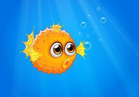 Un brutto pesce palla nell'oceano vettore