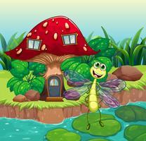Una gigantesca casa dei funghi con una libellula vettore