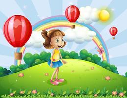 Una ragazza felice guardando le mongolfiere vettore