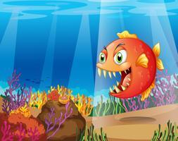 Un piranha nel mare con i coralli vettore