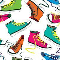 Sfondo di piastrelle di scarpe da tennis. Modello senza cuciture scarpe sportive differenti vettore