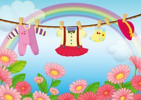 Vestiti del bambino che appendono nel giardino vettore