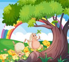 Due animali selvatici vicino all'albero con i fiori