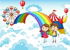 Un carnevale nel cielo con un arcobaleno vettore