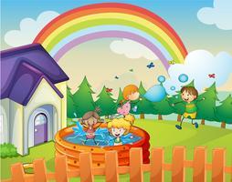 una casa e bambini vettore