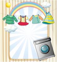 Una lavatrice con vestiti appesi in cima