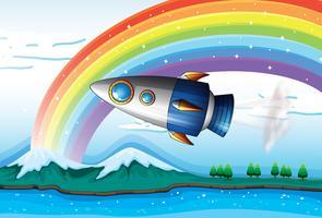 Una navicella spaziale vicino all'arcobaleno sopra l'oceano