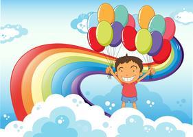Un ragazzo con palloncini in piedi vicino all'arcobaleno vettore