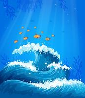 Un'onda e pesci sotto il mare vettore