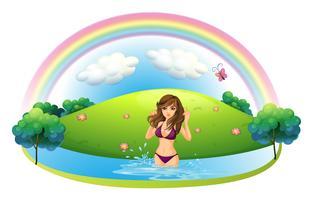 Una donna sexy in bikini in spiaggia vettore