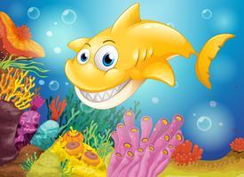 Uno squalo giallo sorridente sotto il mare vettore