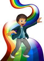 Un ragazzo che balla sopra l'arcobaleno vettore