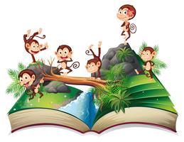 Libro pop-up con scimmie vettore