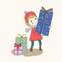 I bambini tengono un grande regalo a sorpresa nel festival di Natale