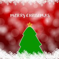 Albero di Natale su rosso con sfondo sfocato morbido neve