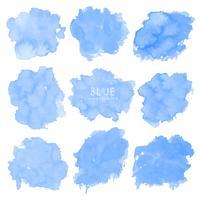 Insieme dell'acquerello blu su fondo bianco, acquerello del colpo della spazzola, illustrazione di vettore.