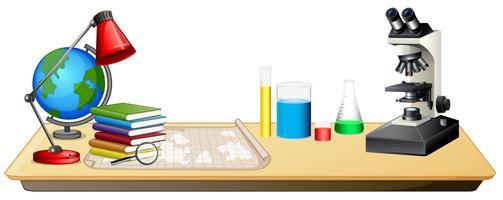 Oggetti educativi su un tavolo vettore