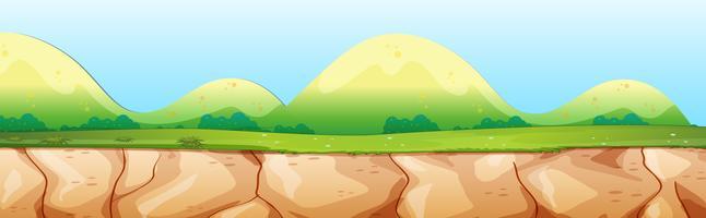 Scena della natura con scogliera e montagna vettore