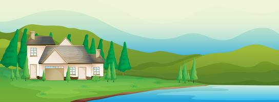 Una casa vicino al fiume vettore