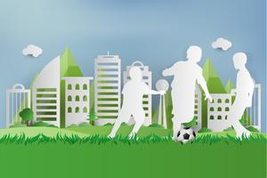 Calciatore su erba verde al parco urbano della città. stile di arte cartacea.