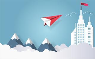 Il concetto di direzione, l'aereo rosso che vola sul cielo con si rannuvola la montagna e la costruzione architettonica con una bandiera sulla cima. vettore