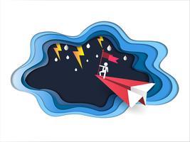 Concetto di leadership e successo, uomo in cima tenendo bandiera con aereo rosso che vola contro il maltempo e fulmine in tempesta.