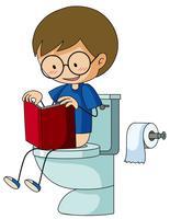 Ragazzo sul libro di lettura toilette