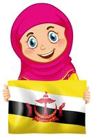 Una ragazza musulmana che tiene la bandiera del Brunei