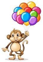 Scimmia carina con palloncini colorati