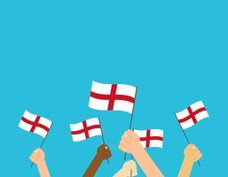 Illustrazione vettoriale mani in possesso di bandiere Inghilterra su sfondo blu