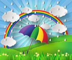Ombrello colorato sotto la pioggia con arcobaleno.