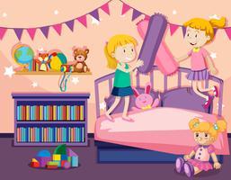 Due ragazze che saltano sul letto