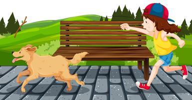 Ragazza con cane nel parco vettore