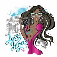 Una bella ragazza con una macchina fotografica viaggia a Las Vegas. Vettore