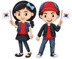 Bambini che tengono la bandiera della Corea del sud vettore