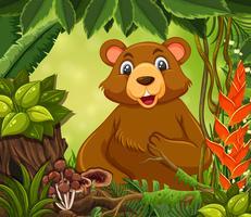 Un simpatico orso nella foresta vettore