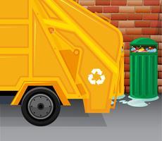 Camion della spazzatura raccogliendo spazzatura