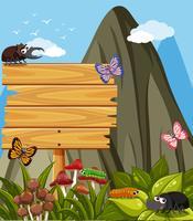 Segno di legno e molti insetti in giardino