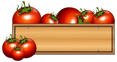 Tavola di legno con pomodori freschi vettore