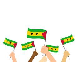Vector l'illustrazione delle mani che tengono le bandiere di Sao Tome e Principe isolate su fondo bianco