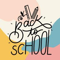 Ritorno a scuola lettering con sfondo colorato vettore