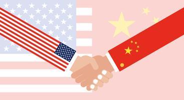 Stringere la mano con la bandiera della Cina e la bandiera degli Stati Uniti