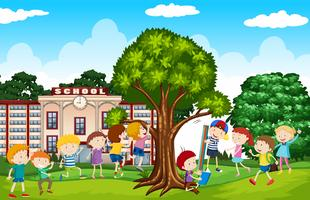 Studenti che giocano nel cortile della scuola vettore