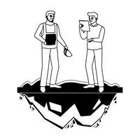 costruttori maschi costruttori operai sul prato