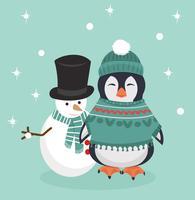 Pinguino in abiti invernali con pupazzo di neve