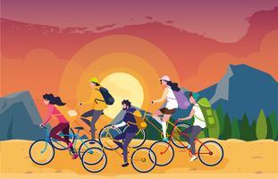 campeggiatori in uno splendido scenario con biciclette vettore