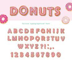 Lettere e numeri dolci del fumetto decorativo disegnato a mano delle ciambelle vettore