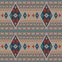 Motivo a maglia etnico colorato geometrico vettore